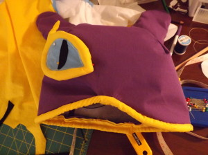 A photo of the unfinished hood with one eye glued on.