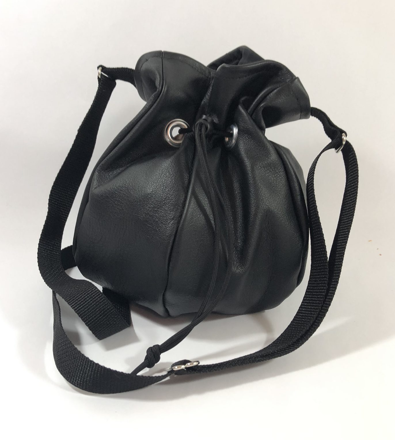 Drawstring crossbody handbag made from black leather.