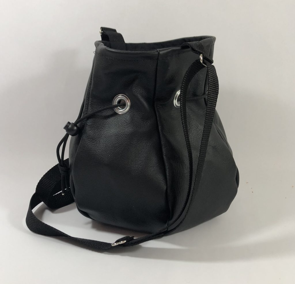 Black leather drawstring handbag.