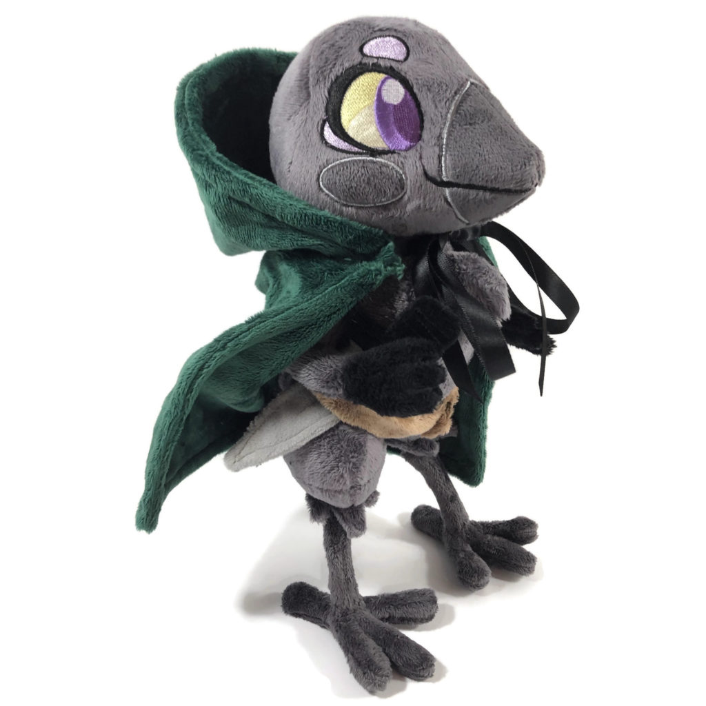 plush gray anthropomorphic crow with embroidered eyes, a green cloak, and a fabric dagger in her belt