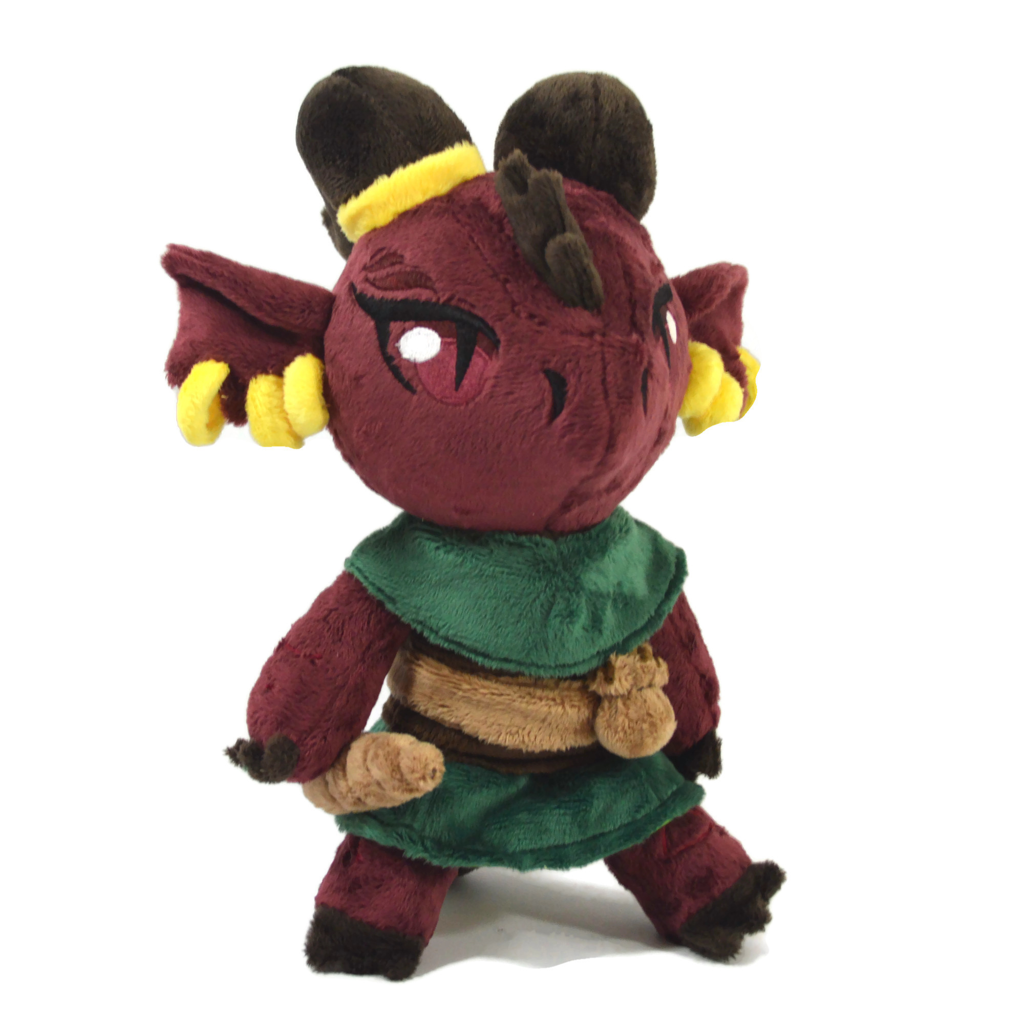 A red Kobold plush with brown horns and a green outfit.